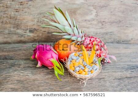 Gyümölcssaláta sárkány gyümölcs fél kókusz egészséges étkezés Stock fotó © galitskaya
