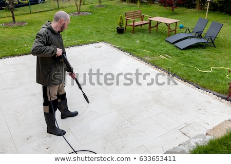 Cleaning terrace with high-pressure water blaster Stock photo © brebca