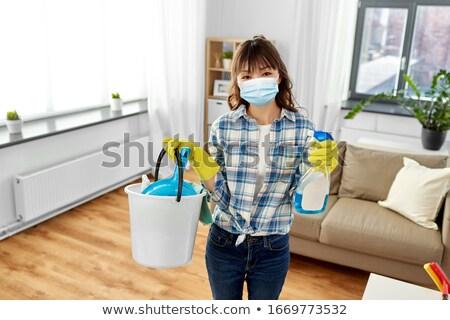 Asian femme seau nettoyage maison ménage Photo stock © dolgachov