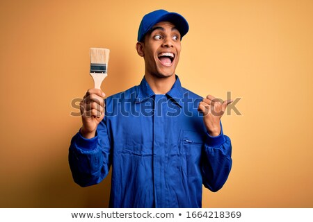 Decorator pointing up Stock photo © photography33