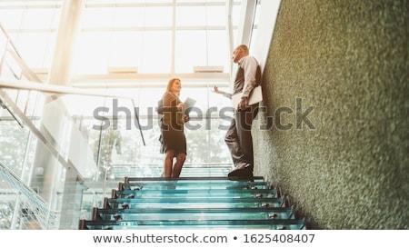 Heldere zakenvrouw instructies geïsoleerd witte business Stockfoto © wavebreak_media