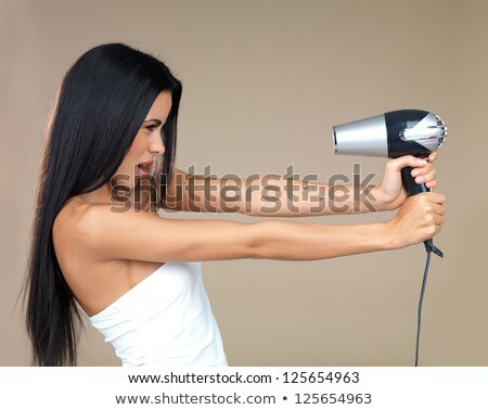 woman enjoying having her hair blow dried stock photo © discovod