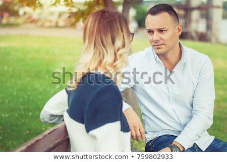 glimlachend · paar · praten · buitenshuis · man · natuur - stockfoto © is2