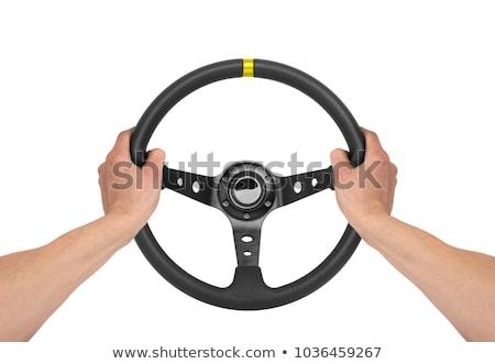 Foto stock: Hombre · volante · joven · negro · las · senales · de · tráfico