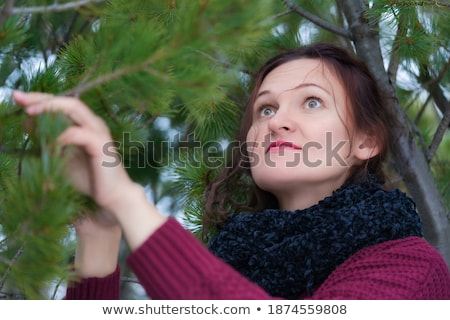 Cute woman in a jersey standing in autumn park Stock photo © Alones