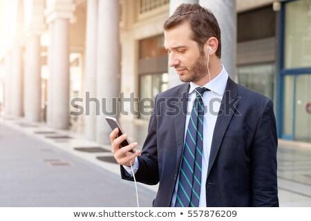 человека смартфон ходьбе город люди Сток-фото © dolgachov