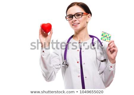 paciente · pastillas · sonriendo · jóvenes · médico - foto stock © traimak