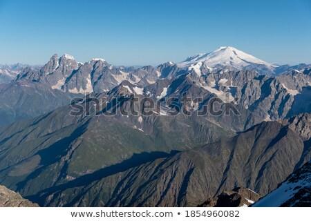 Gyönyörű csúcs Kaukázus hegy tájkép felhők Stock fotó © Kotenko