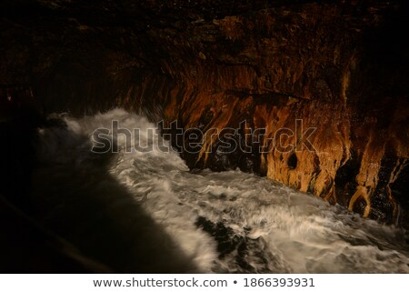 idyllic coastal bays and sea caves exploring stock photo © lovleah