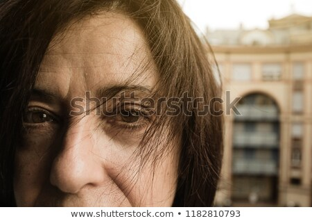 Stock photo: Close-up of happy senior woman looking at camera in the sunshine in garden