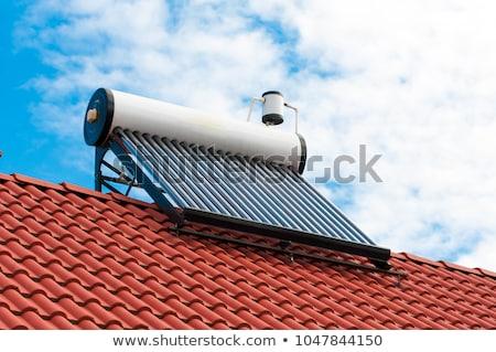Zonne-energie water verwarming hemel zon home Stockfoto © AndreyPopov