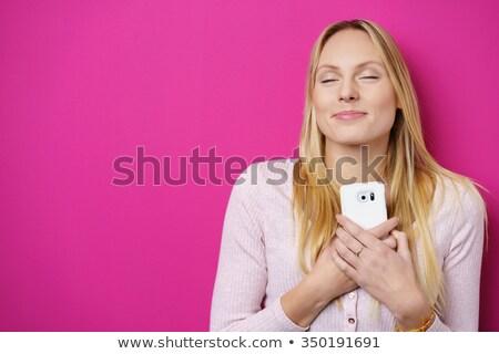 Kép romantikus fiatal nő kéz a kézben mellkas néz Stock fotó © deandrobot