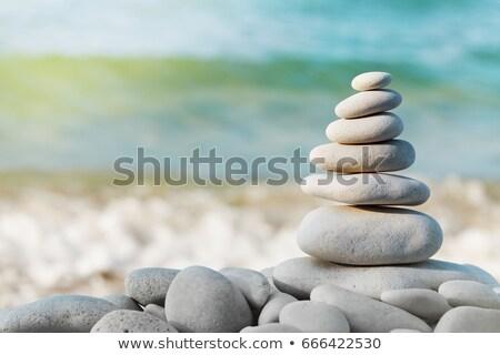 çakıl taş piramit mavi deniz gökyüzü Stok fotoğraf © rufous