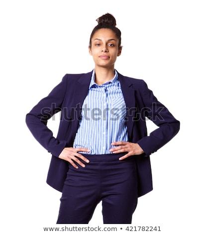 Beautiful businesswoman with hands on hips Stock photo © wavebreak_media