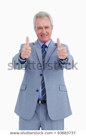 Uśmiechnięty dojrzały handlowiec kciuk w górę biały Zdjęcia stock © wavebreak_media