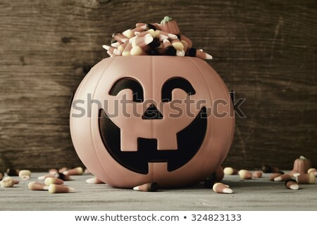 carved pumpkin full of halloween candies, filtered Stock photo © nito