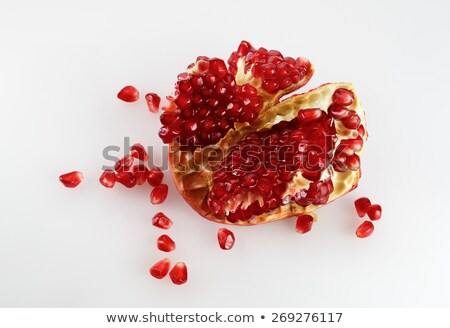 cut pomegranate with seeds around Stock photo © fanfo