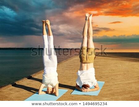 mulher · jovem · exercer · borda · mar · céu · mãos - foto stock © dolgachov
