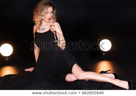 Verleidelijk blonde vrouw drinken champagne naar spiegel Stockfoto © deandrobot