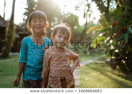 Two kids in traditional clothes in garden Stock photo © bluering