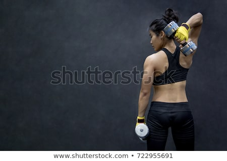 a young woman weight training exercise stock photo © bluering