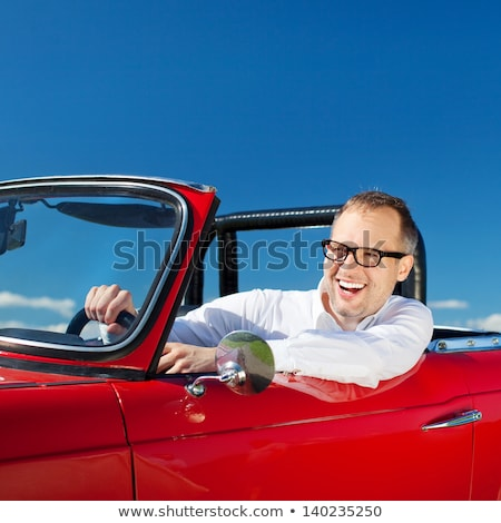 happy man driving convertible car over sky Stock photo © dolgachov