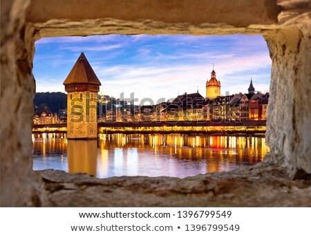 Luzern Kapelbrucke and riverfront architecture famous Swiss land Stock photo © xbrchx