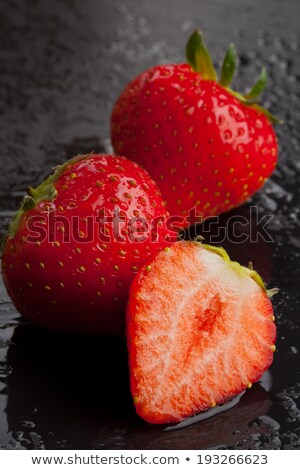 Whole strawberries on black background with water drops. Wet strawberries. Frame, copy space. Top vi Stock photo © Illia