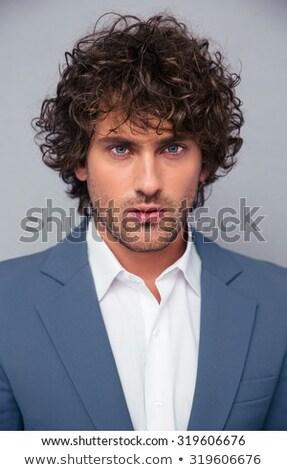 Knap jonge gekruld zakenman coltrui Stockfoto © deandrobot
