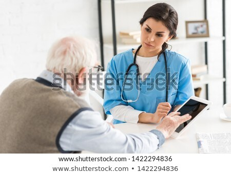 doctor man using a digital tablet Stock photo © nito