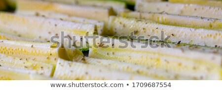 Panorama banner of fresh seasoned zucchini slices Stock photo © Giulio_Fornasar