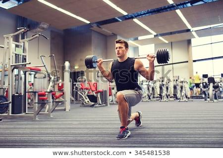 Młody człowiek siłowni przystojny ciało wykonywania Zdjęcia stock © boggy