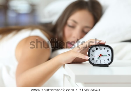 a woman stopping an alarm clock Stock photo © photography33