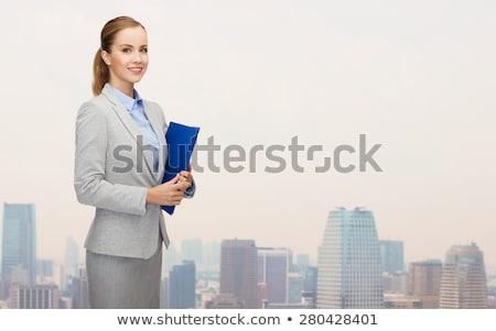 üzletasszony tart mappa nő laptop energia Stock fotó © photography33