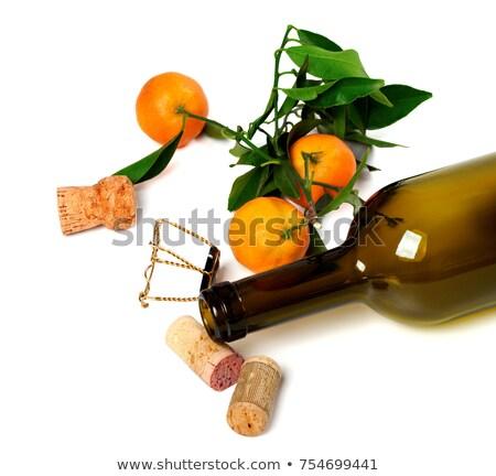 Empty bottle of wine, corks, muselet and mandarins Stock photo © BSANI