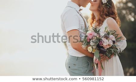Mutlu düğün çift çiçekler genç Stok fotoğraf © dariazu