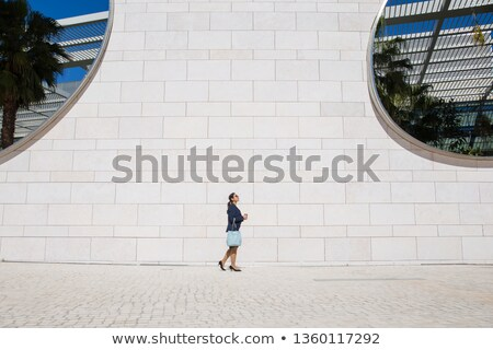 Side view of woman in greenhouse Stock photo © deandrobot