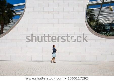 Widok z boku kobieta szklarnia czerwona sukienka stwarzające roślin Zdjęcia stock © deandrobot