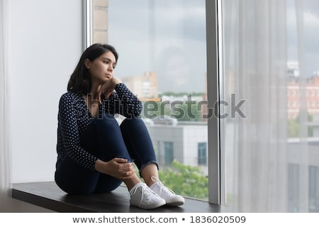 Pensive Asian woman on windowsill Stock photo © deandrobot