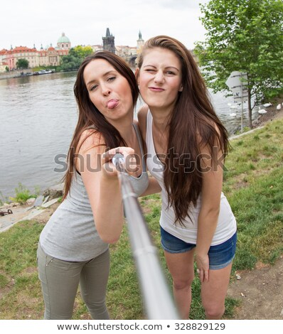 Two girls hanging out in the park Stock photo © bluering