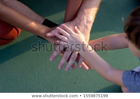 Masculina entrenador baloncesto jugadores manos Foto stock © wavebreak_media
