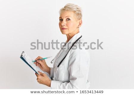 Zdjęcia stock: W · średnim · wieku · kobiet · lekarza · piśmie · schowek · medycznych