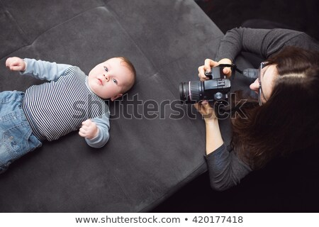 Boy taking a photo of his Mum Stock photo © IS2