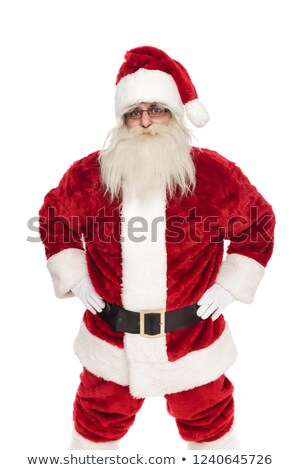 portrait of old saint nick wearing sunglasses holding hips stock photo © feedough