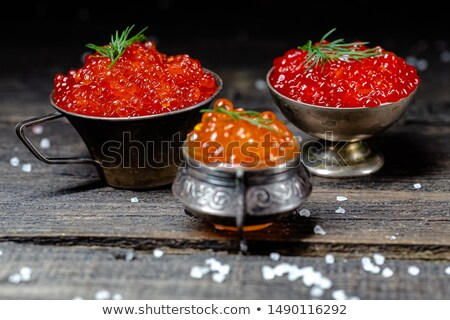 Stock photo: Large pile of salmon red caviar