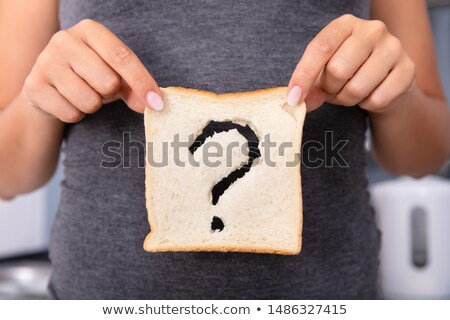 Woman Holding Slice Of Bread With Question Mark Sign Stock photo © AndreyPopov