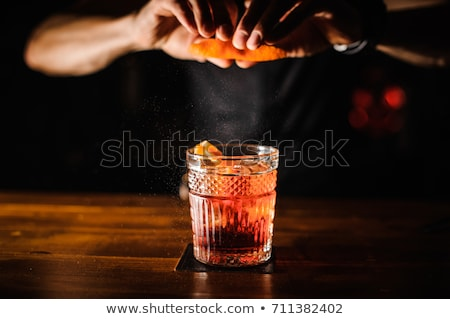 Waitress with cocktail drink Stock photo © Lopolo