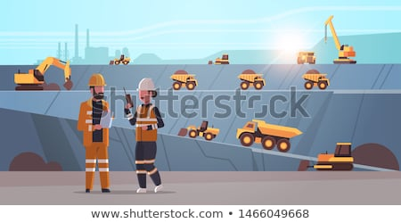 Man and woman as workers on excavator in quarry Stock photo © Kzenon