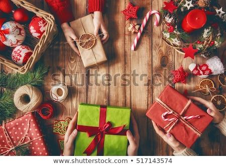 woman preparing xmas gifts stock photo © choreograph