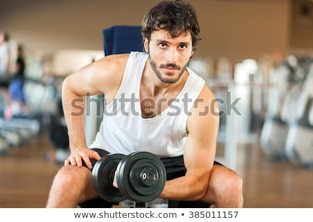 Homme gymnase biceps haltères sport Photo stock © Jasminko